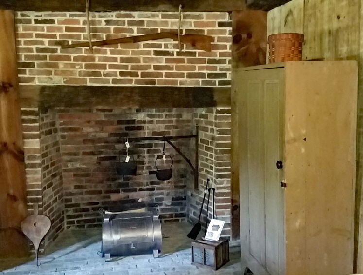 DINING ROOM: This fireplace was installed in 1930. The original home had a fireplace here that was removed during the 1800 addition.